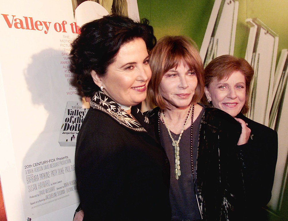 ". Barbara Parkins, Lee Grant and Patty Duke, left to right, three original cast members from the 1967 film of the Jacqueline Susann novel ""Valley of the Dolls,\"" reunited in New York, Wednesday evening Feb. 16, 2000, for a screening and panel discussion of the movie by cable\'s American Movie Classics. (AP Photo/Richard Drew)"