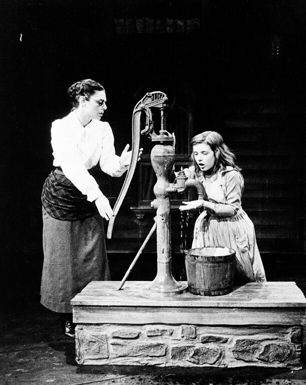 ". Anne Bancroft, left, and Patty Duke are shown in character on stage in the Boadway play ""The Miracle Worker\"" in New York City, Oct. 1959.  Bancroft plays the role of Anne Sullivan, who teaches the blind and deaf Helen Keller, played by Duke, to communicate.  (AP Photo)"