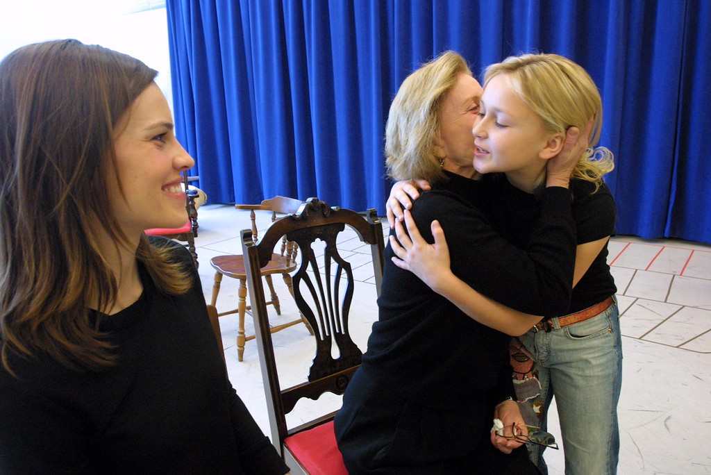 ". Patty Duke, center, and Skye McCole Bartusiak, right, embrace as Hilary Swank looks on during a photo opportunity in a rehearsal studio in New York  Friday Feb 21, 2003.  Swank and Bartusiak will be starring in a new Broadway production of WIlliam Gibson\'s ""The Miracle Worker\"" with Swank as \'Annie Sullivan\' and Bartusiak as \'Helen Keller,\' a role played by Duke over 40 years ago. (AP Photo/Tina Fineberg)"