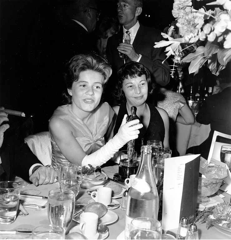 ". Actress Patty Duke, 16, admires her golden Oscar statuette at the 35th annual Academy Award presentation and dinner at the Santa Monica Civic Auditorium, Ca., on April 8, 1963.  At right is her co-manager, Ethel Ross.  Patty was named best supporting actress for her portrayal of Helen Keller in ""The Miracle Worker.\""  (AP Photo)"