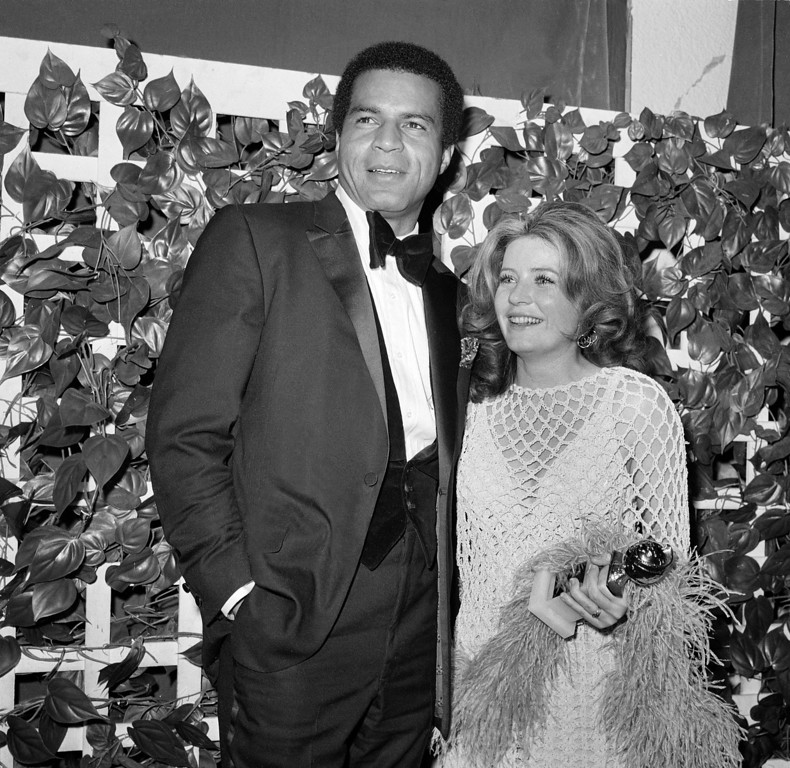 ". Actor Lloyd Haynes of the television series  ""Room 222\"" and actress Patty Duke are seen at the Golden Globe awards in Hollywood, Feb., 1970.  (AP Photo/Harold P. Matosian)"