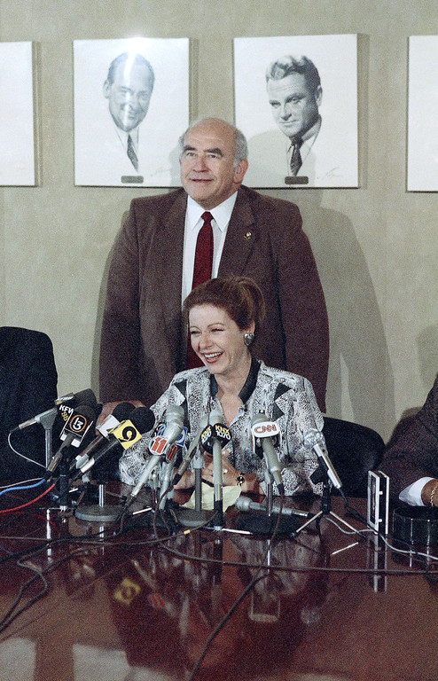 . Outgoing Screen Actors Guild President Ed Asner stands behind Patty Duke, newly-elected President, during news conference in Los Angeles, Wednesday, Nov. 6, 1985.  (AP Photo/Mike Tweed)
