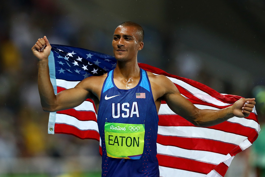 . RIO DE JANEIRO, BRAZIL - AUGUST 18:  Ashton Eaton of the United States celebrates winning gold overall after the Men\'s Decathlon 1500m on Day 13 of the Rio 2016 Olympic Games at the Olympic Stadium on August 18, 2016 in Rio de Janeiro, Brazil.  (Photo by Dean Mouhtaropoulos/Getty Images)