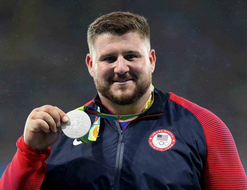 . RIO DE JANEIRO, BRAZIL - AUGUST 18:  Silver medalist, Joe Kovacs of the United States, poses on the podium during the medal ceremony for the Men\'s Shot Put Final on Day 13 of the Rio 2016 Olympic Games at the Olympic Stadium on August 18, 2016 in Rio de Janeiro, Brazil.  (Photo by Ryan Pierse/Getty Images)