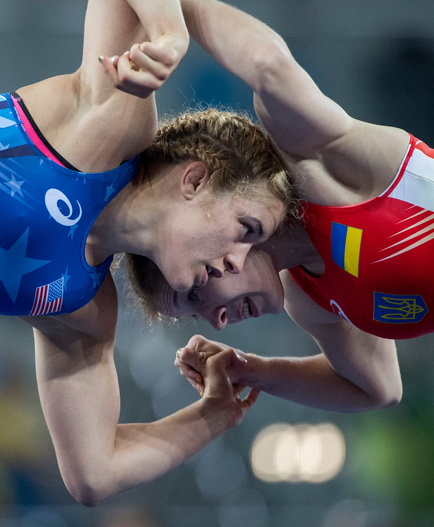 . United States\' Helen Louise Maroulis battles Ukraine\'s  Yuliia Khavadzhy Blahinya during the women\'s wrestling freestyle 53-kg competition at the 2016 Summer Olympics in Rio de Janeiro, Brazil, Thursday, Aug. 18, 2016. (Michael Goulding, Orange County Register)