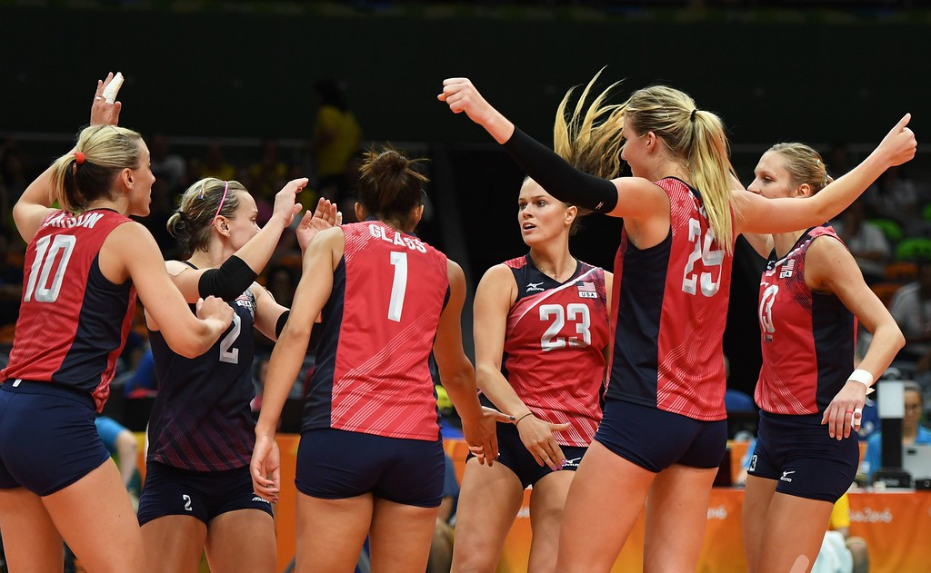 . USA\'s Kelsey Robinson (C) and teammates react during the women\'s semi-final volleyball match between Serbia and USA at the Maracanazinho stadium in Rio de Janeiro on August 18, 2016, during the Rio 2016 Olympic Games. (ERIC FEFERBERG/AFP/Getty Images)