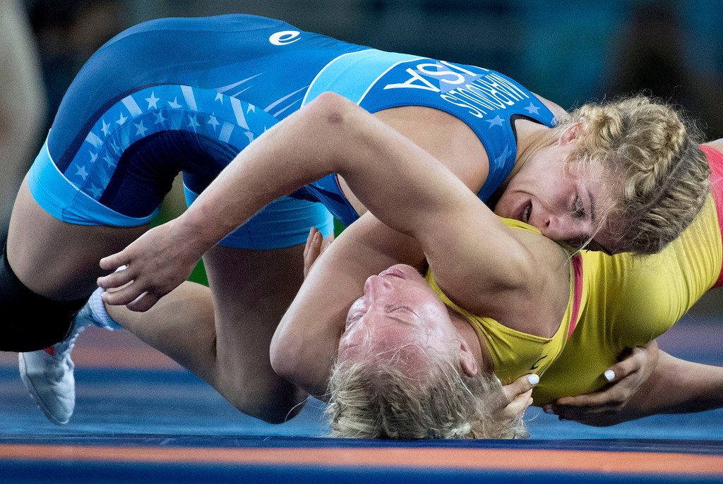 . United States\' Helen Louise Maroulis rolls Sofia Magdalena Mattsson over before defeating her in the semi-final during the women\'s wrestling freestyle 53-kg competition at the 2016 Summer Olympics in Rio de Janeiro, Brazil, Thursday, Aug. 18, 2016.(Michael Goulding, Orange County Register)