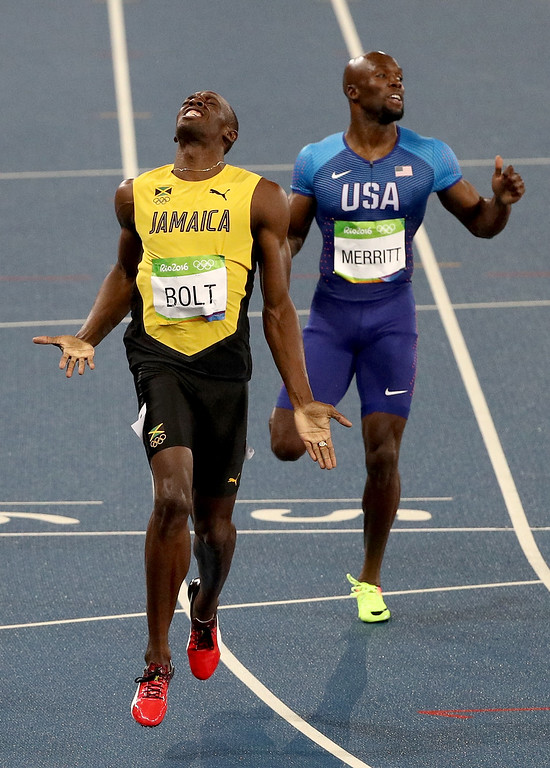 . RIO DE JANEIRO, BRAZIL - AUGUST 18:  Usain Bolt of Jamaica wins the Men\'s 200m Final ahead of Lashawn Merritt of the United States on Day 13 of the Rio 2016 Olympic Games at the Olympic Stadium on August 18, 2016 in Rio de Janeiro, Brazil.  (Photo by Patrick Smith/Getty Images)