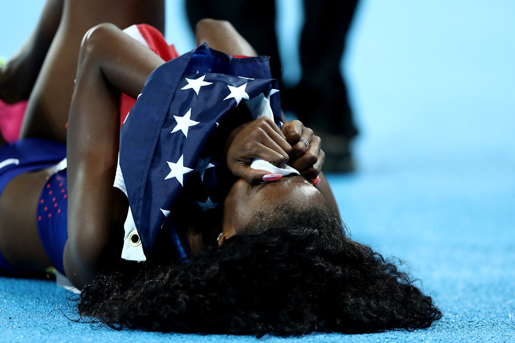 . RIO DE JANEIRO, BRAZIL - AUGUST 18:  Ashley Spencer of the United States celebrates winning bronze in the Women\'s 400m Hurdles Final on Day 13 of the Rio 2016 Olympic Games at the Olympic Stadium on August 18, 2016 in Rio de Janeiro, Brazil.  (Photo by Ezra Shaw/Getty Images)