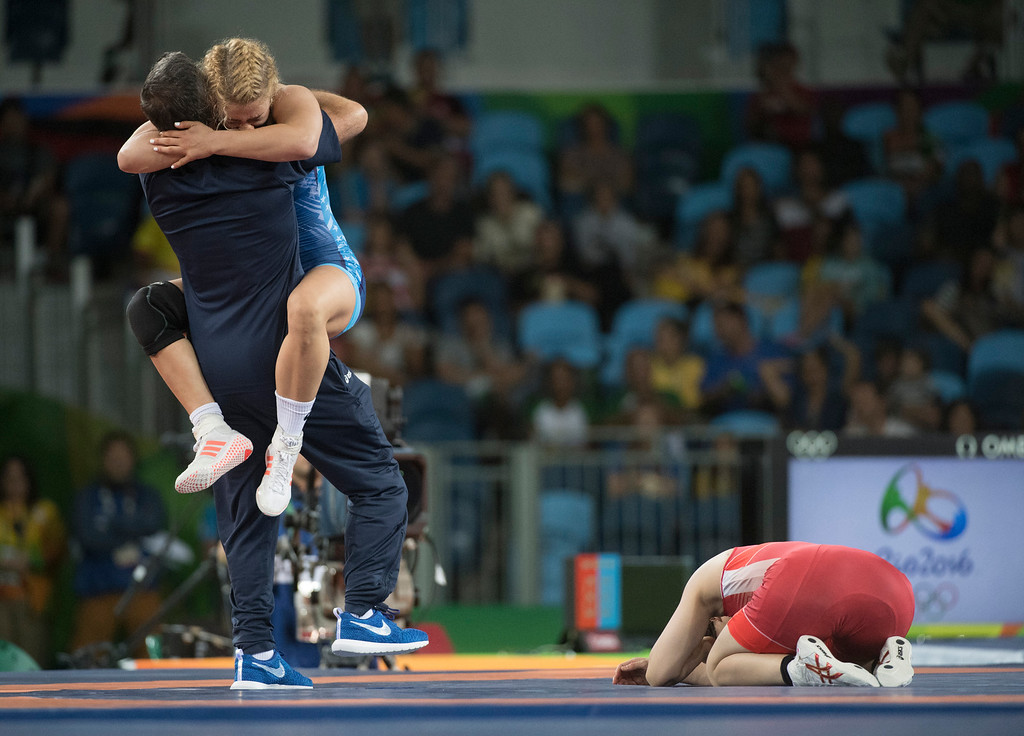 . United States\' Helen Louise Maroulis of Huntington Beach leaps into the arms of coach Valentin Kalika\' arms after defeating Japan\'s Soari Yoshida to win the first gold medal ever  for USA women\'s wrestling during the women\'s wrestling freestyle 53-kg competition at the 2016 Summer Olympics in Rio de Janeiro, Brazil, Thursday, Aug. 18, 2016. (Michael Goulding, Orange County Register)