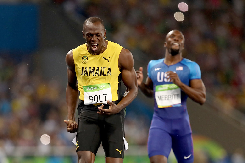 . RIO DE JANEIRO, BRAZIL - AUGUST 18:  Usain Bolt of Jamaica wins the Men\'s 200m Final ahead of Lashawn Merritt of the United States on Day 13 of the Rio 2016 Olympic Games at the Olympic Stadium on August 18, 2016 in Rio de Janeiro, Brazil.  (Photo by Cameron Spencer/Getty Images)