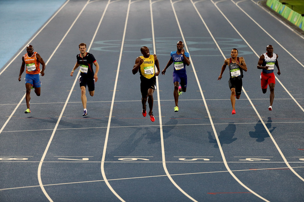 . RIO DE JANEIRO, BRAZIL - AUGUST 18:  Christophe Lemaitre of France, Usain Bolt of Jamaica, Lashawn Merritt of the United States and Andre de Grasse of Canada compete in the Men\'s 200m Final on Day 13 of the Rio 2016 Olympic Games at the Olympic Stadium on August 18, 2016 in Rio de Janeiro, Brazil.  (Photo by Patrick Smith/Getty Images)