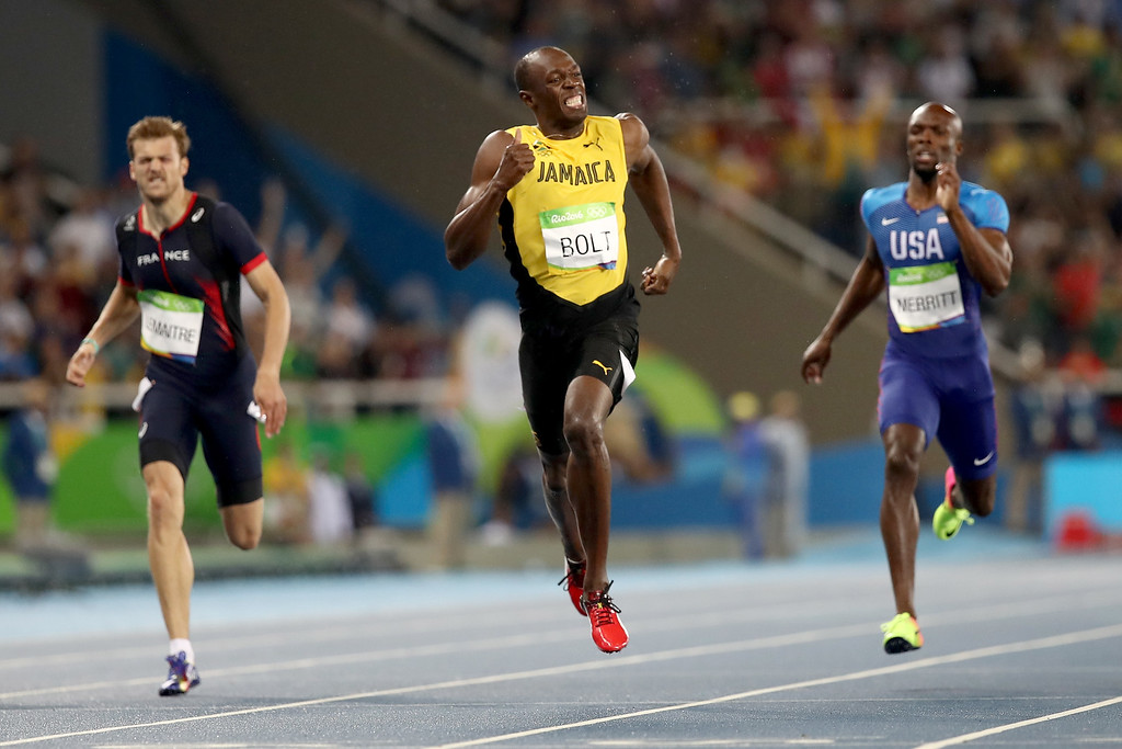 . RIO DE JANEIRO, BRAZIL - AUGUST 18:  Usain Bolt of Jamaica wins the Men\'s 200m Final ahead of Lashawn Merritt of the United States and Christophe Lemaitre of France on Day 13 of the Rio 2016 Olympic Games at the Olympic Stadium on August 18, 2016 in Rio de Janeiro, Brazil.  (Photo by Cameron Spencer/Getty Images)