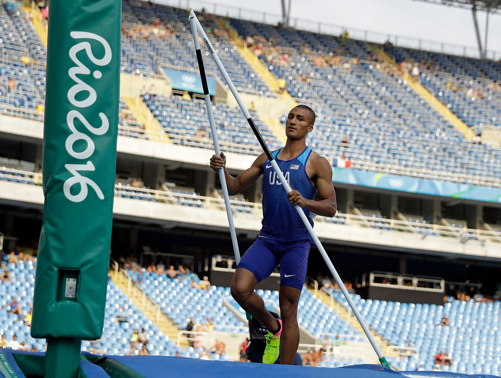 . United States\' Ashton Eaton holds the bar that he snapped when failing with a clearance in men\'s decathlon pole vault during the athletics competitions of the 2016 Summer Olympics at the Olympic stadium in Rio de Janeiro, Brazil, Thursday, Aug. 18, 2016. (AP Photo/Matt Dunham)