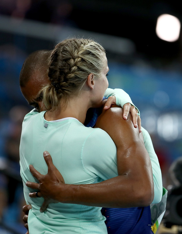 . RIO DE JANEIRO, BRAZIL - AUGUST 18:  Ashton Eaton of the United States embraces wife Brianne Theisen-Eaton after the Men\'s Decathlon 1500m and winning gold overall on Day 13 of the Rio 2016 Olympic Games at the Olympic Stadium on August 18, 2016 in Rio de Janeiro, Brazil.  (Photo by Cameron Spencer/Getty Images)