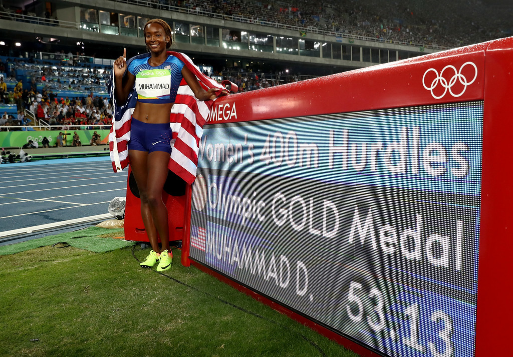 . RIO DE JANEIRO, BRAZIL - AUGUST 18:  Dalilah Muhammad of the United States celebrates winning gold in the Women\'s 400m Hurdles Final on Day 13 of the Rio 2016 Olympic Games at the Olympic Stadium on August 18, 2016 in Rio de Janeiro, Brazil.  (Photo by Alexander Hassenstein/Getty Images)