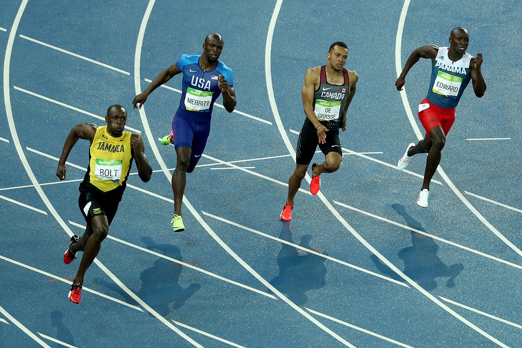 . RIO DE JANEIRO, BRAZIL - AUGUST 18:  Usain Bolt of Jamaica, Lashawn Merritt of the United States and Andre de Grasse of Canada compete in the Men\'s 200m Final on Day 13 of the Rio 2016 Olympic Games at the Olympic Stadium on August 18, 2016 in Rio de Janeiro, Brazil.  (Photo by Lars Baron/Getty Images)