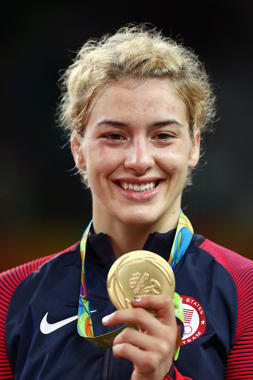 . RIO DE JANEIRO, BRAZIL - AUGUST 18:  Gold medalist Helen Louise Maroulis of the United States celebrates during the medal ceremony after the Women\'s Freestyle 53 kg competition on Day 13 of the Rio 2016 Olympic Games at Carioca Arena 2 on August 18, 2016 in Rio de Janeiro, Brazil.  (Photo by Julian Finney/Getty Images)