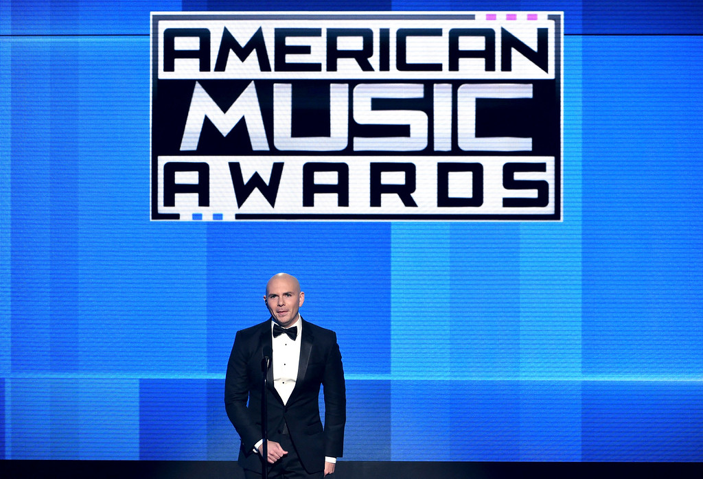 . LOS ANGELES, CA - NOVEMBER 23:  Host Pitbull speaks onstage at the 2014 American Music Awards at Nokia Theatre L.A. Live on November 23, 2014 in Los Angeles, California.  (Photo by Kevin Winter/Getty Images)