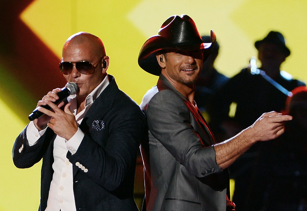 . LAS VEGAS, NV - APRIL 08:  Recording artists Pitbull (L) and Tim McGraw perform onstage during Tim McGraw\'s Superstar Summer Night presented by the Academy of Country Music at the MGM Grand Garden Arena on April 8, 2013 in Las Vegas, Nevada.  (Photo by Ethan Miller/Getty Images)