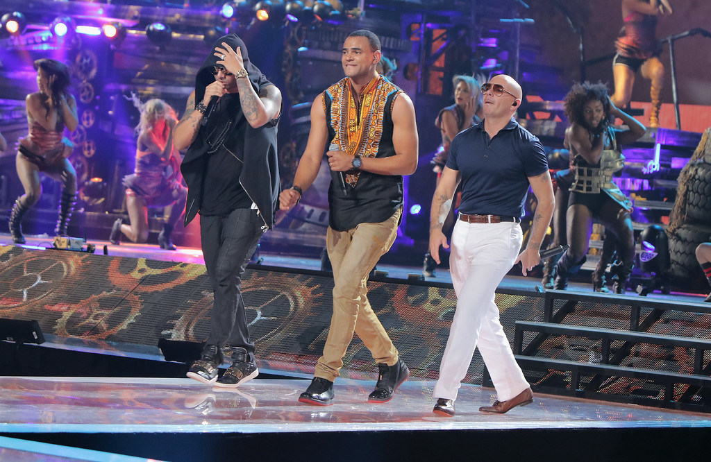. MIAMI, FL - JULY 15:  (L-R) Wisin, Mohombi and Pitbull perform onstage during Univision\'s Premios Juventud 2015 rehearsal at Bank United Center on July 15, 2015 in Miami, Florida.  (Photo by John Parra/Getty Images For Univision)