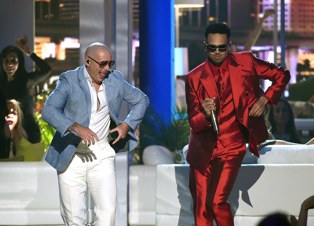 . LAS VEGAS, NV - MAY 17:  Rapper Pitbull (L) and recording artist Chris Brown perform during the 2015 Billboard Music Awards at MGM Grand Garden Arena on May 17, 2015 in Las Vegas, Nevada.  (Photo by Ethan Miller/Getty Images)