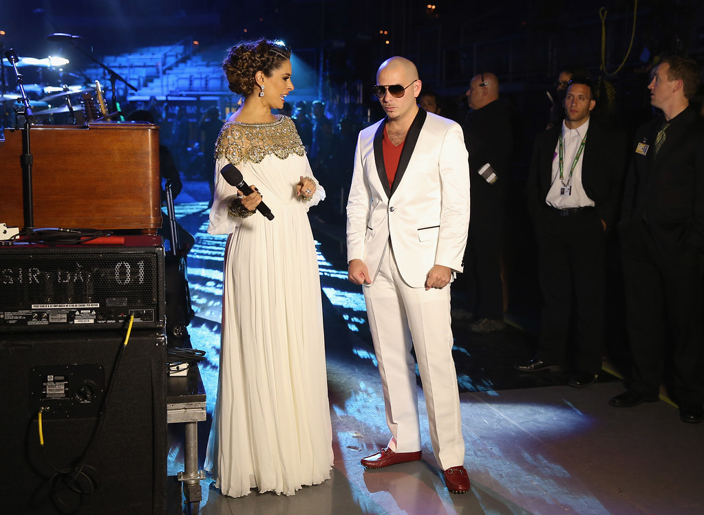 . LAS VEGAS, NV - NOVEMBER 15:  (L-R) Giselle Blondet and recording artist Pitbull backstage at the 13th annual Latin GRAMMY Awards held at the Mandalay Bay Events Center on November 15, 2012 in Las Vegas, Nevada.  (Photo by Christopher Polk/Getty Images for Latin Recording Academy)