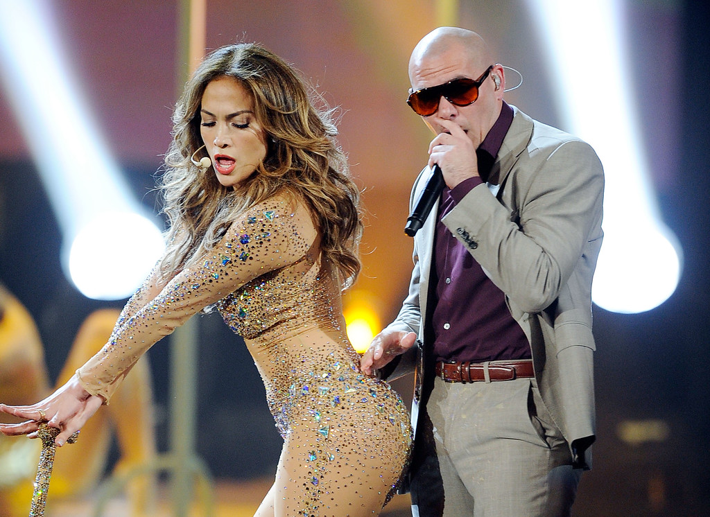 . LOS ANGELES, CA - NOVEMBER 20:  Singer Jennifer Lopez and rapper Pitbull perform onstage at the 2011 American Music Awards held at Nokia Theatre L.A. LIVE on November 20, 2011 in Los Angeles, California.  (Photo by Kevork Djansezian/Getty Images)