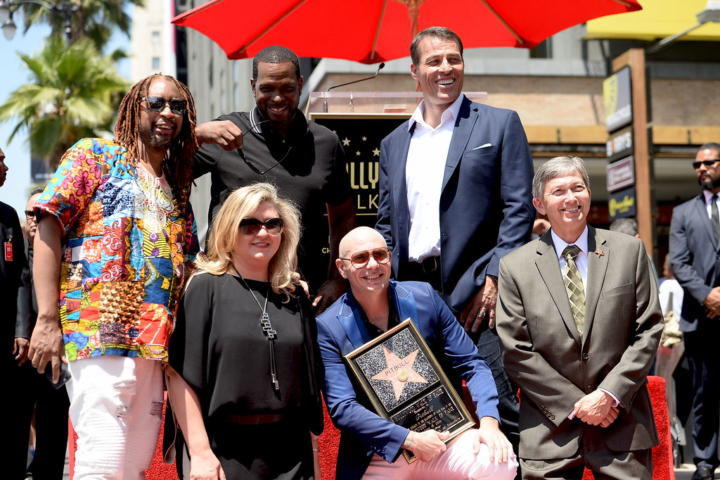 . HOLLYWOOD, CA - JULY 15:  (Back Row L-R) Rapper Lil Jon, Luther Campbell, Tony Robbins, (Front Row L-R) Hollywood Chamber of Commerce Chair of the Board Fariba Kalantari, rapper Pitbull, and President/CEO of the Hollywood Chamber of Commerce Leron Gubler attend a ceremony honoring Pitbull with a Star on The Hollywood Walk of Fame on July 15, 2016 in Hollywood, California.  (Photo by Matt Winkelmeyer/Getty Images)