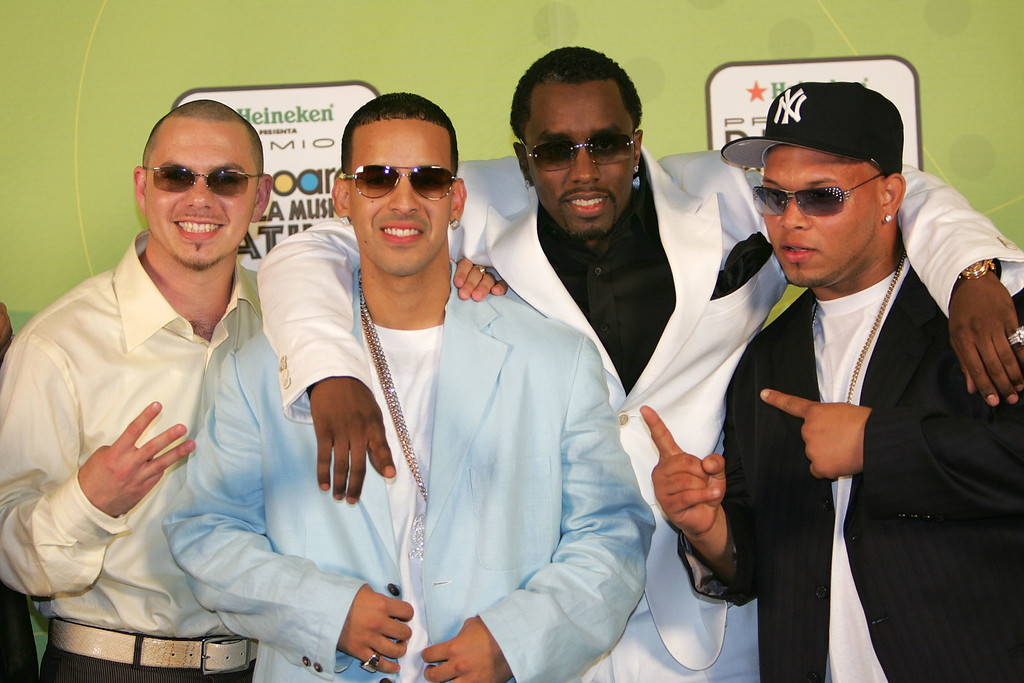 ". MIAMI - APRIL 28:  Rappers Pitbull, (L) Daddy Yankee (2nd-L) and Sean ""P Diddy\"" Combs (C) pose backstage at 2005 Billboard Latin Music Awards at the Miami Arena April 28, 2005 in Miami, Florida.  (Photo by Paul Hawthorne/Getty Images)"