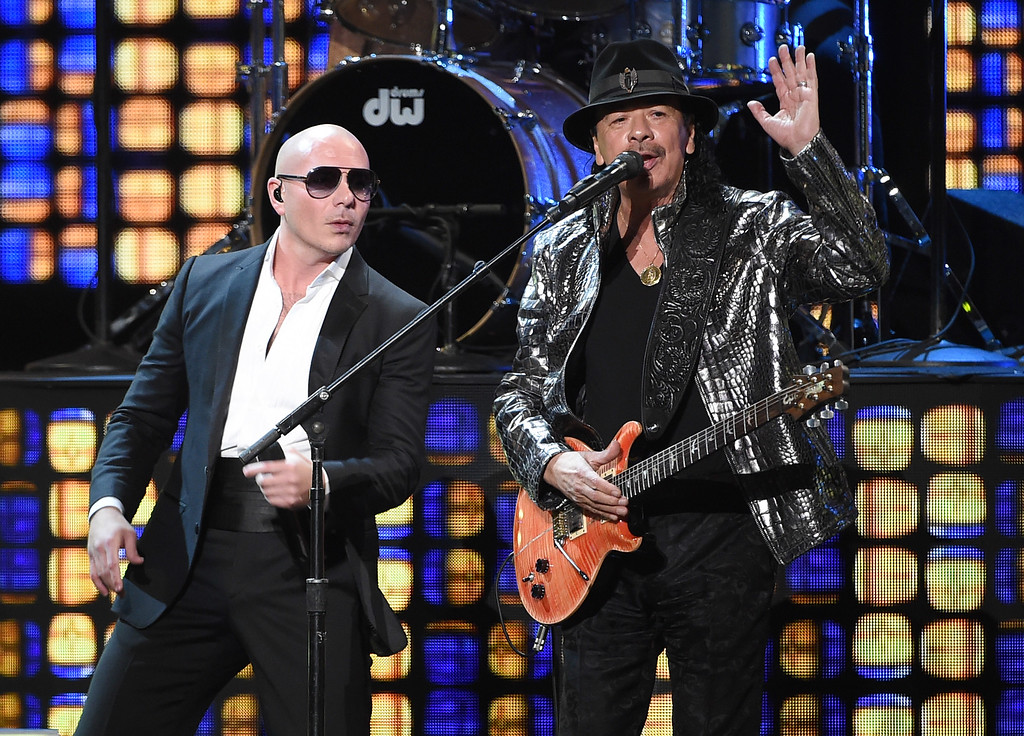 . LAS VEGAS, NV - NOVEMBER 20:  Recording artists Pitbull (L) and Carlos Santana perform during the 15th annual Latin GRAMMY Awards at the MGM Grand Garden Arena on November 20, 2014 in Las Vegas, Nevada.  (Photo by Ethan Miller/Getty Images)