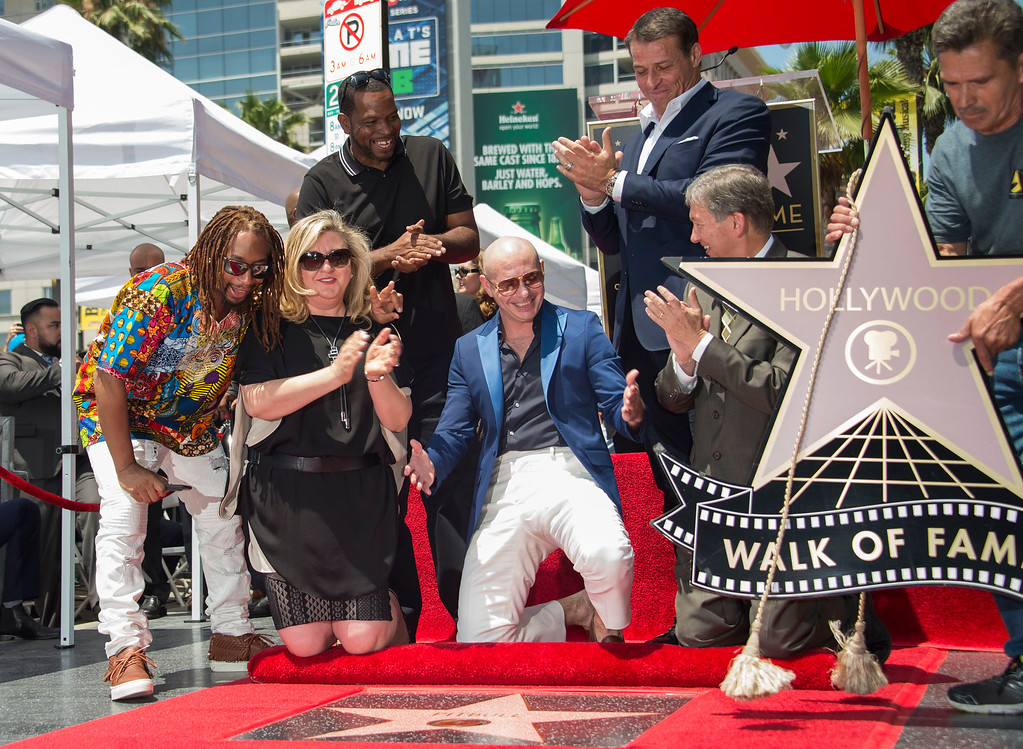 . Recording artist Pitbull (C) is honored with a star on the Hollywood Walk of Fame, July 15, 2016, in Hollywood, California. / AFP / VALERIE MACON        (Photo credit should read VALERIE MACON/AFP/Getty Images)
