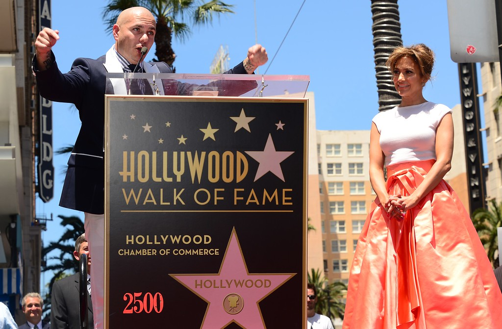 . International superstar Jennifer Lopez looks on as Pitbull addresses the audience during the unveilng ceremony of her star in Hollywood, California on June 20, 2013.   (FREDERIC J. BROWN/AFP/Getty Images)