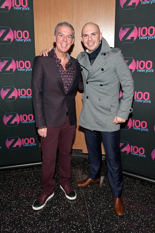 ". NEW YORK, NY - DECEMBER 01:  Elvis Duran (L) poses with Pitbull during his visit to ""The Elvis Duran Z100 Morning Show\"" at One World Observatory on December 1, 2015 in New York City.  (Photo by D Dipasupil/Getty Images)"