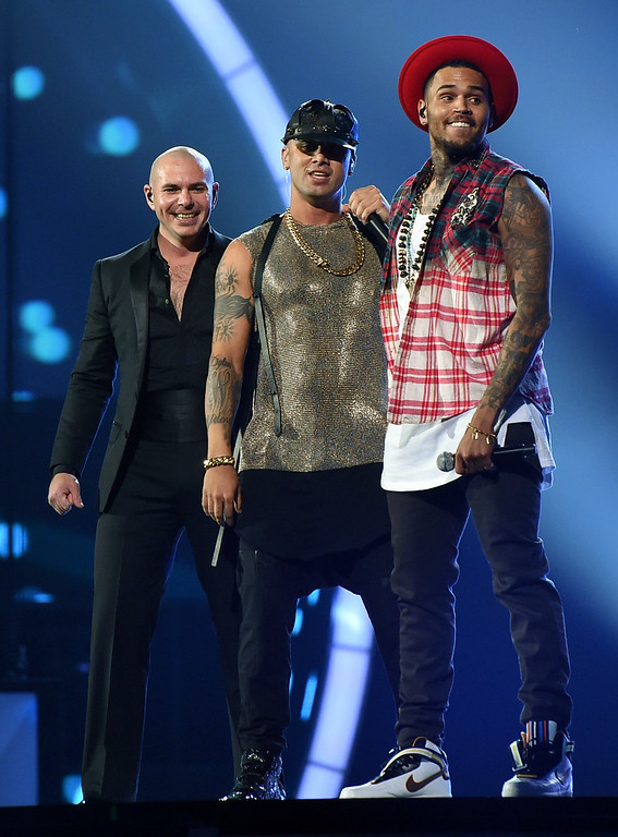 . LAS VEGAS, NV - NOVEMBER 20:  (L-R) Recording artists Pitbull, Wisin and Chris Brown perform during the 15th annual Latin GRAMMY Awards at the MGM Grand Garden Arena on November 20, 2014 in Las Vegas, Nevada.  (Photo by Ethan Miller/Getty Images)
