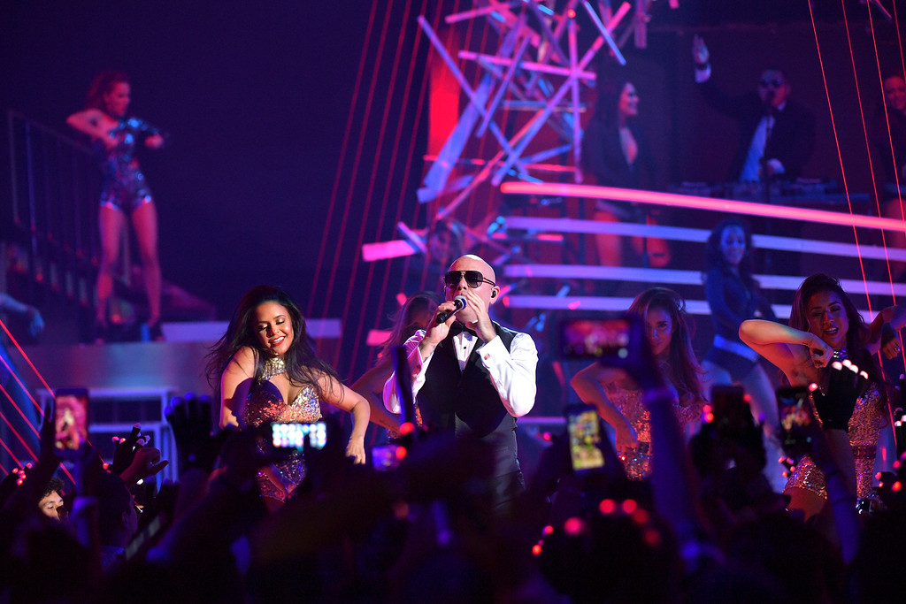 . MIAMI, FL - JULY 14:  Pitbull performs onstage during the Univision\'s 13th Edition Of Premios Juventud Youth Awards at Bank United Center on July 14, 2016 in Miami, Florida.  (Photo by Rodrigo Varela/Getty Images for Univision)