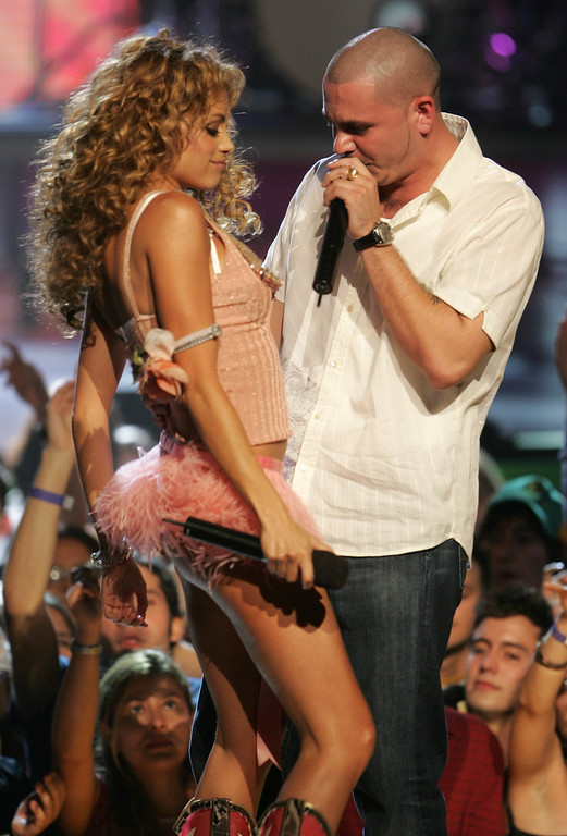 . MIAMI BEACH, FL - OCTOBER 21:  Paulina Rubio and Pitbull perform on stage at the 2004 MTV Video Music Awards Latin America at the Jackie Gleason Theater October 21, 2004 in Miami Beach, Florida.  (Photo by Scott Gries/Getty Images)