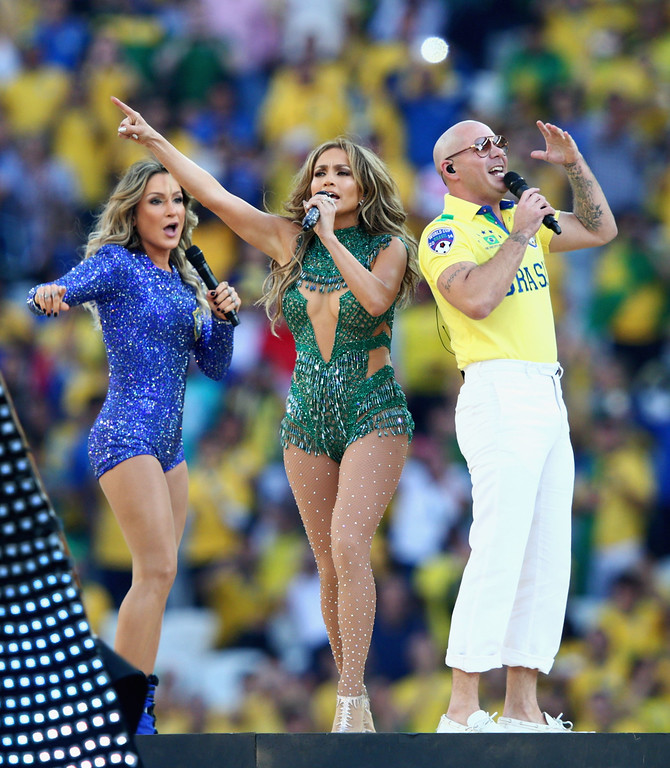 . SAO PAULO, BRAZIL - JUNE 12:  (L-R) Singers Claudia Leitte, Jennifer Lopez and Pitbull perform during the Opening Ceremony of the 2014 FIFA World Cup Brazil prior to the Group A match between Brazil and Croatia at Arena de Sao Paulo on June 12, 2014 in Sao Paulo, Brazil.  (Photo by Adam Pretty/Getty Images)