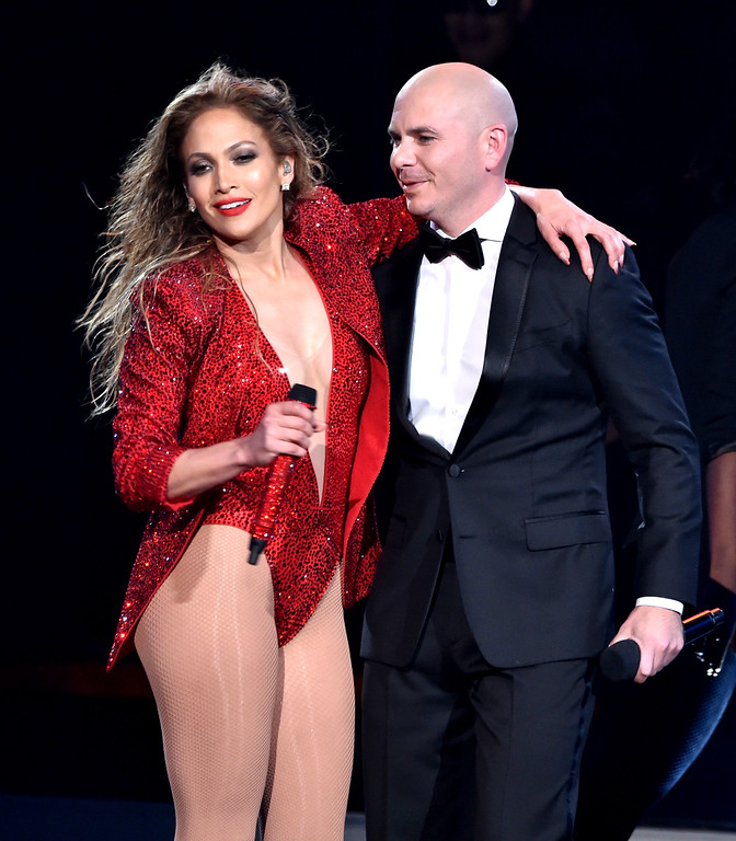 . LOS ANGELES, CA - NOVEMBER 23:  Recording artist Jennifer Lopez (L) and host Pitbull perform onstage at the 2014 American Music Awards at Nokia Theatre L.A. Live on November 23, 2014 in Los Angeles, California.  (Photo by Kevin Winter/Getty Images)