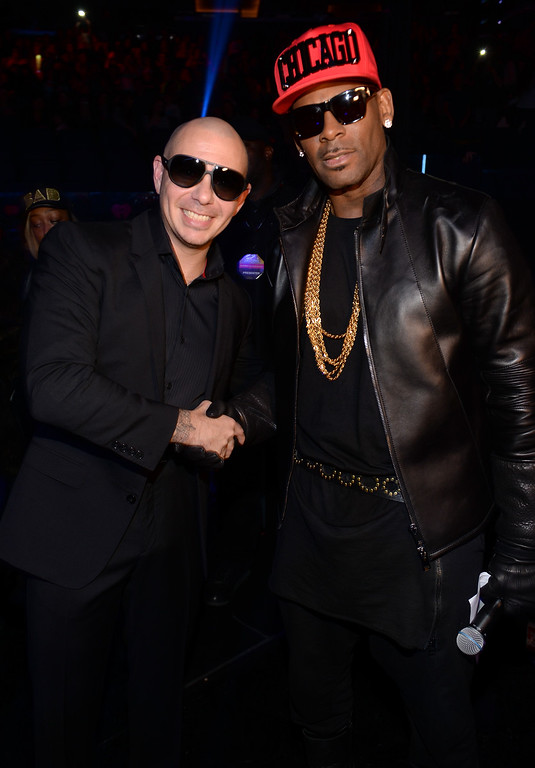 . NEW YORK, NY - DECEMBER 13:  Pitbull and R. Kelly pose backstage at Z100\'s Jingle Ball 2013, presented by Aeropostale, at Madison Square Garden on December 13, 2013 in New York City.  (Photo by Dimitrios Kambouris/Getty Images for Clear Channel)
