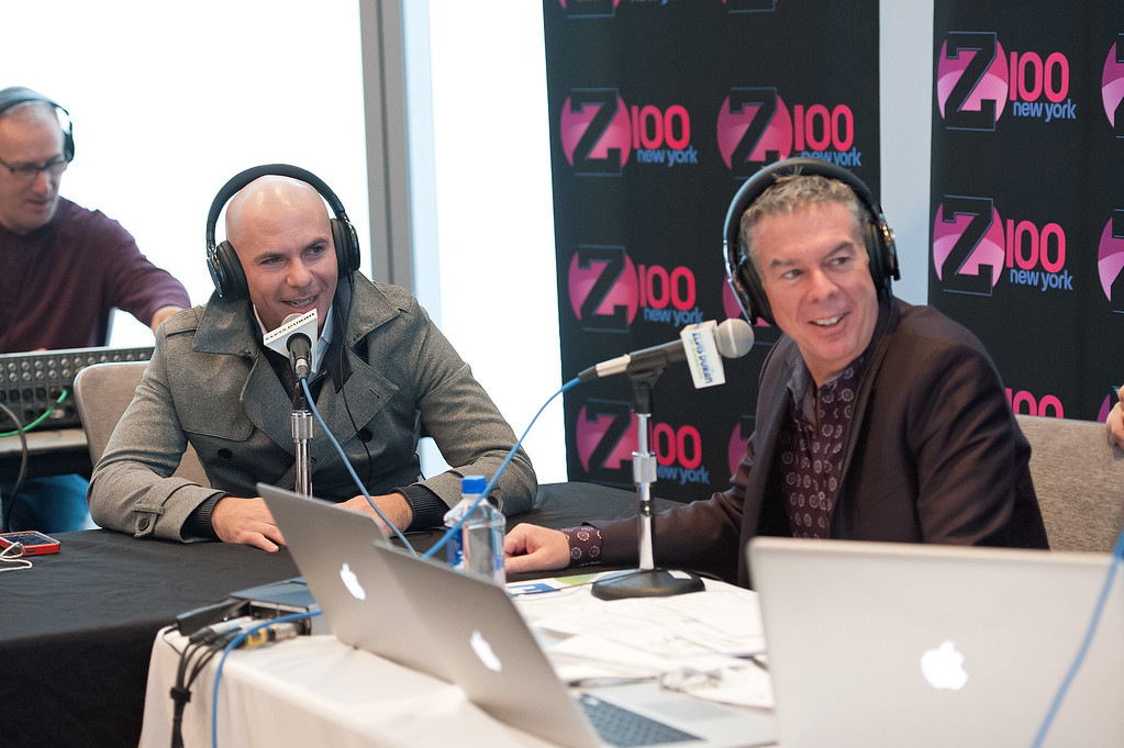 ". NEW YORK, NY - DECEMBER 01:  Elvis Duran (R) interviews Pitbull during his visit to ""The Elvis Duran Z100 Morning Show\"" at One World Observatory on December 1, 2015 in New York City.  (Photo by D Dipasupil/Getty Images)"