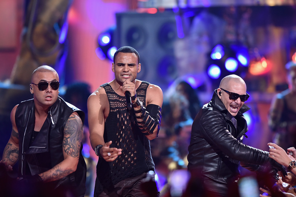 . MIAMI, FL - JULY 16:  Wisin, Mohombi, and Pitbull perform onstage at Univision\'s Premios Juventud 2015 at Bank United Center on July 16, 2015 in Miami, Florida.  (Photo by Rodrigo Varela/Getty Images For Univision)