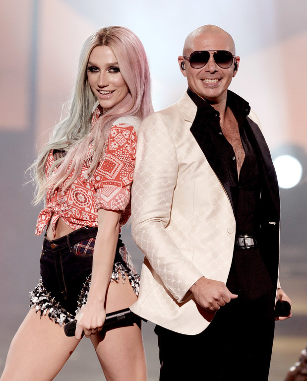 . LOS ANGELES, CA - NOVEMBER 24:  Singers Ke$ha, (L) and Pitbull perform onstage during the 2013 American Music Awards at Nokia Theatre L.A. Live on November 24, 2013 in Los Angeles, California.  (Photo by Kevin Winter/Getty Images)