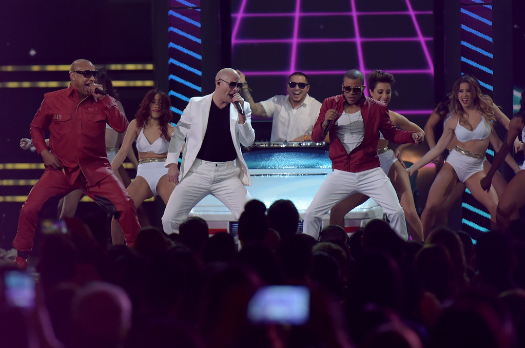 . MIAMI, FL - FEBRUARY 19: Pitbull and Gente de Zona perform onstage at the 2015 Premios Lo Nuestros Awards at American Airlines Arena on February 19, 2015 in Miami, Florida.  (Photo by Rodrigo Varela/Getty Images For Univision)