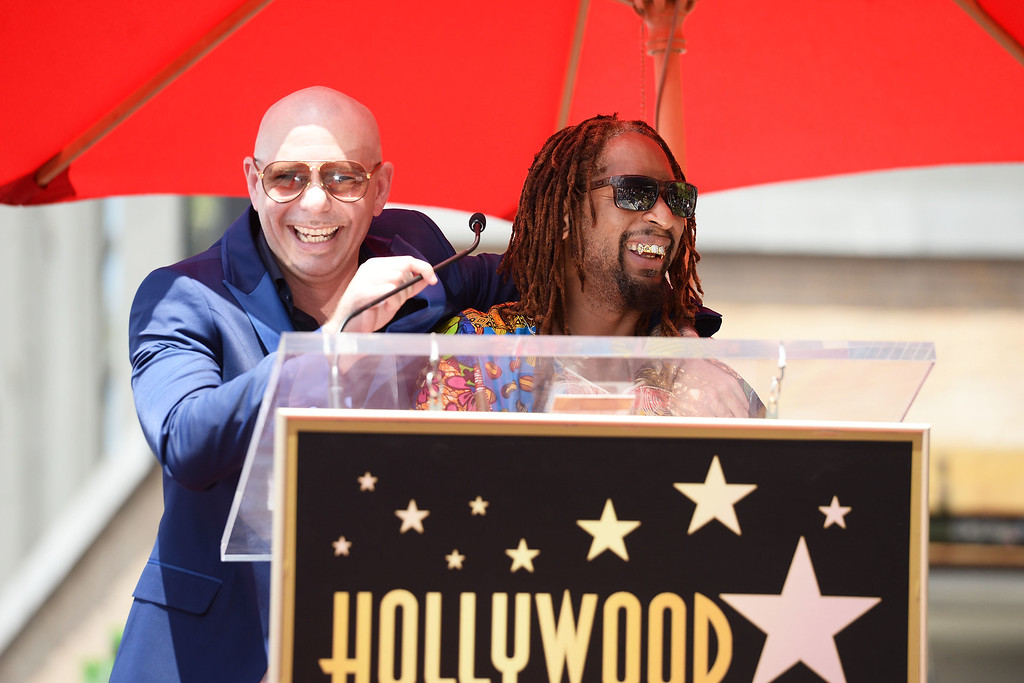 . HOLLYWOOD, CA - JULY 15:  Rappers Pitbull (L) and Lil Jon speak onstage as Pitbull is honored with a Star on The Hollywood Walk of Fame on July 15, 2016 in Hollywood, California.  (Photo by Matt Winkelmeyer/Getty Images)
