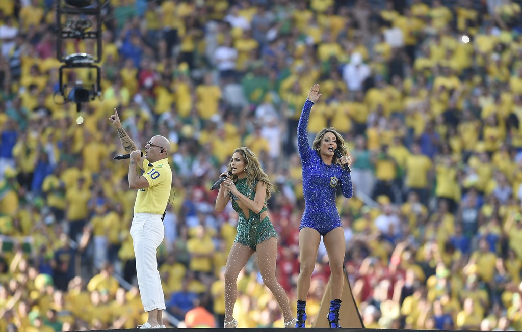 . From L-R) US rapper Pitbull, Brazilian pop singer Claudia Leiite and US singer Jennifer Lopez perform during the opening ceremony of the 2014 FIFA World Cup at the Corinthians Arena in Sao Paulo on June 12, 2014.  (DIMITAR DILKOFF/AFP/Getty Images)
