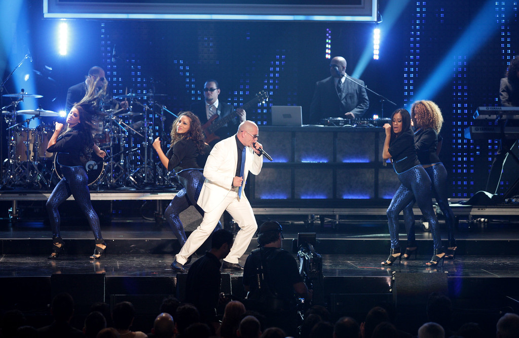 . LOS ANGELES, CA - SEPTEMBER 17:  Rapper Pitbull performs onstage at the 2009 ALMA Awards held at Royce Hall on September 17, 2009 in Los Angeles, California.  (Photo by Robert Benson/Getty Images For NCLR)