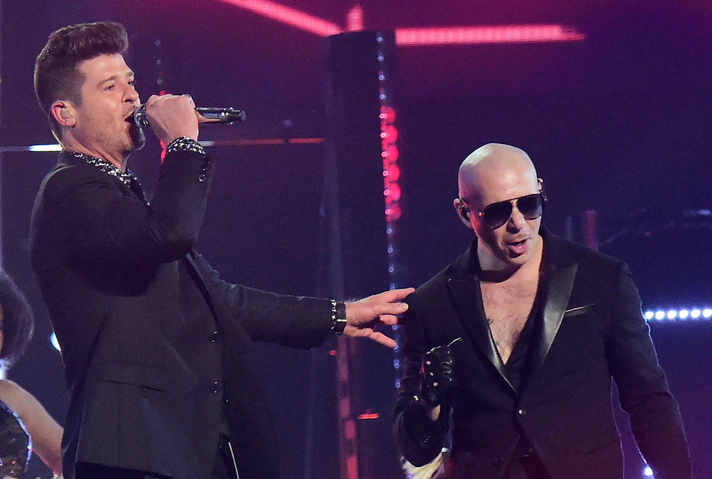. Robin Thicke (L) and Pitbull perform on stage during the 58th Annual Grammy Awards in Los Angeles, California on February 15, 2016. (ROBYN BECK/AFP/Getty Images)