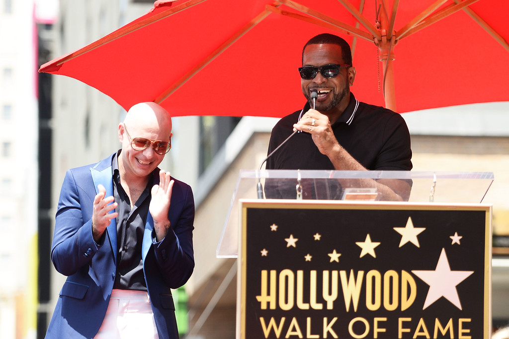 . HOLLYWOOD, CA - JULY 15:  Pitbull (L) and Luther Campbell speak onstage as Pitbull is honored with a Star on The Hollywood Walk of Fame on July 15, 2016 in Hollywood, California.  (Photo by Matt Winkelmeyer/Getty Images)