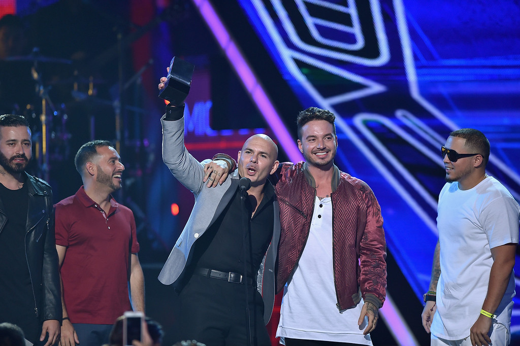 . MIAMI, FL - JULY 16: Pitbull and J Balvin accept an award onstage at Univision\'s Premios Juventud 2015 at Bank United Center on July 16, 2015 in Miami, Florida.  (Photo by Rodrigo Varela/Getty Images For Univision)